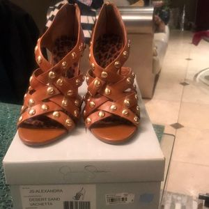 Jessica Simpson brown strap he gold studded shoe.